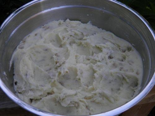 Mash potatoes with butter and milk