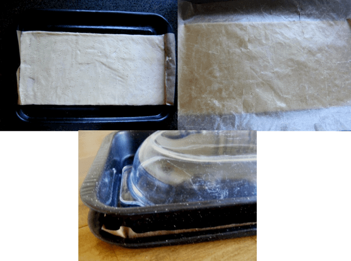 Place another sheet of greaseproof paper over the top and then a heavy baking tray