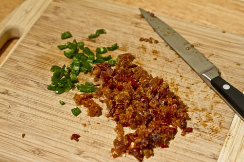 Remove the seeds from the peppers, and finely chop