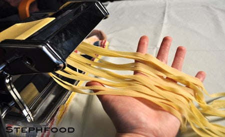 Run the stretched dough through the fettuccine-sized cutters