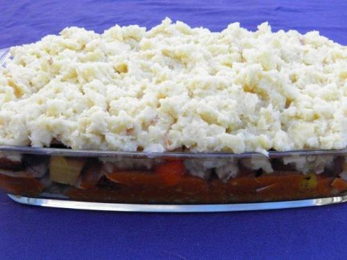 Top with potatoes, spread evenly over entire surface