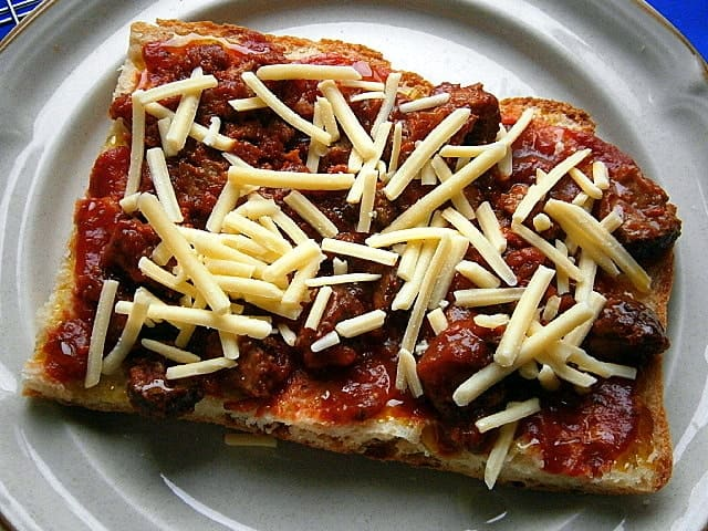 Unbaked frozen pizza base with toppings