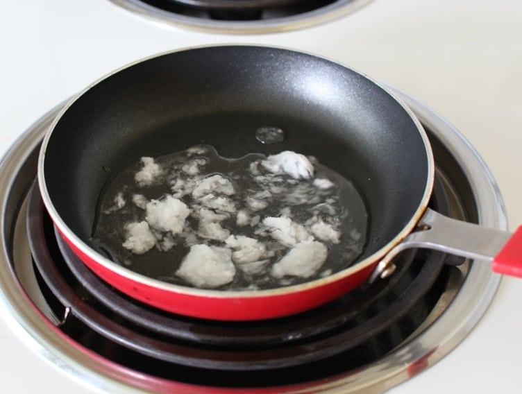 Warm-coconut-oil-in-a-small-saucepan