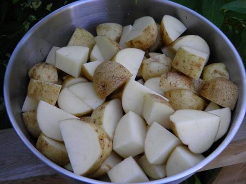 Wash potatoes and cut into quarters