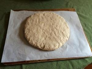 roll the dough into a circle shape