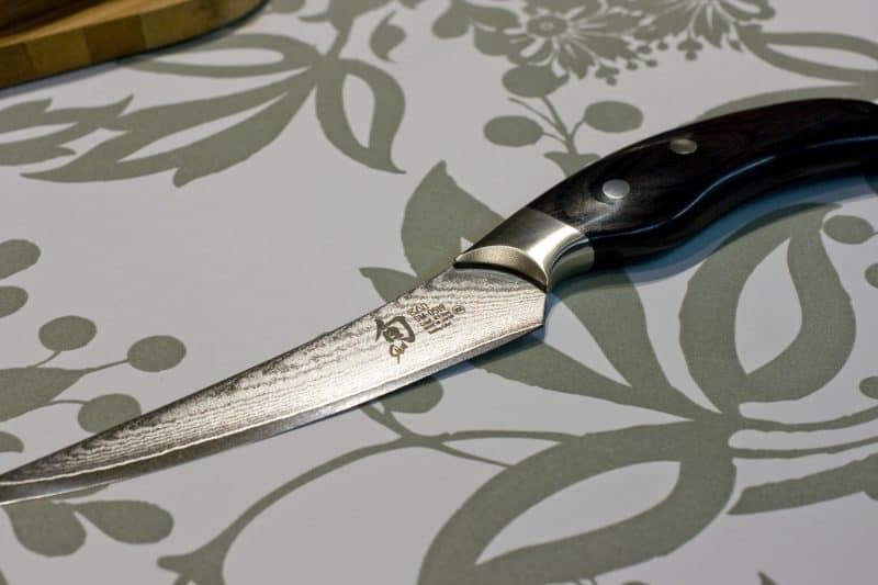 Boning knife on table