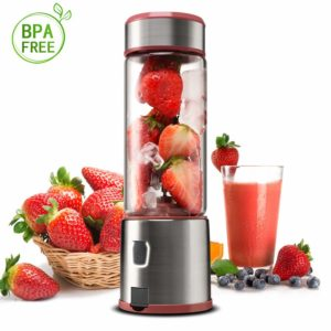 The KACSOO Single Serve Glass Personal Blender is pictured alongside a bowl of fruit and a glass of blended strawberries