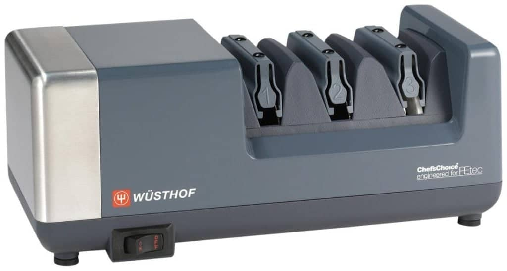The Wusthof PEtec Electric Sharpener is pictured over a field of white