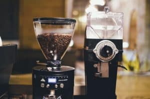 A pair of coffee grinders are pictured in a coffee shop
