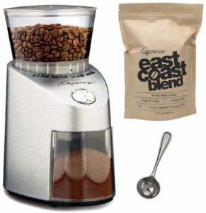 The Capresso 565.05 Infinity Stainless Steel Conical Burr Grinder is pictured over a field of white