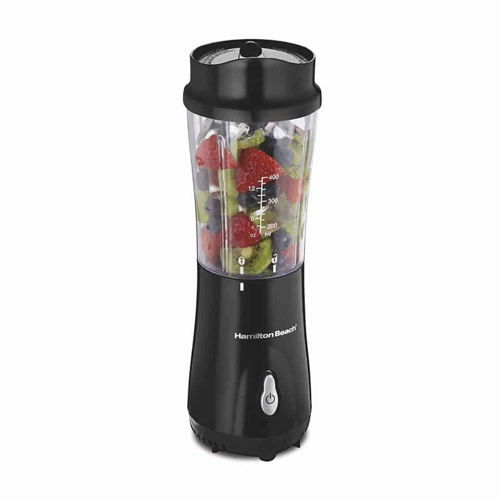 The Hamilton Beach Personal Smoothie Blender is pictured over a field of white