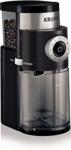 The KRUPS 8000035978 GX5000 Professional Electric Coffee Burr Grinder is pictured over a field of white