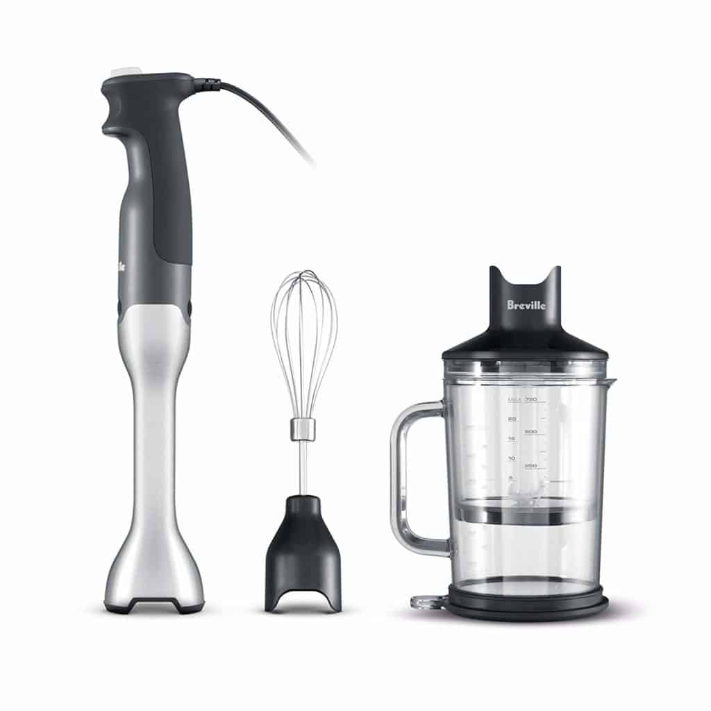 The Breville BSB510XL Control Grip Immersion Blender is pictured next to the included mixing jug