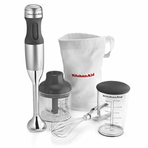 The KitchenAid KHB2351CU 3-Speed Hand Blender is pictured alongside its included accessories