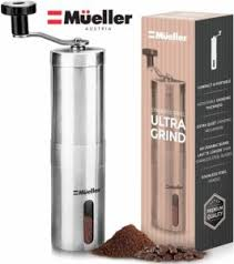 The Mueller Austria Manual Whole Bean Coffee Grinder is pictured over a field of white