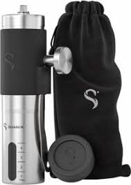 The Shanik Premium Quality Stainless Steel Manual Coffee Grinder i s pictured beside its carrying bag