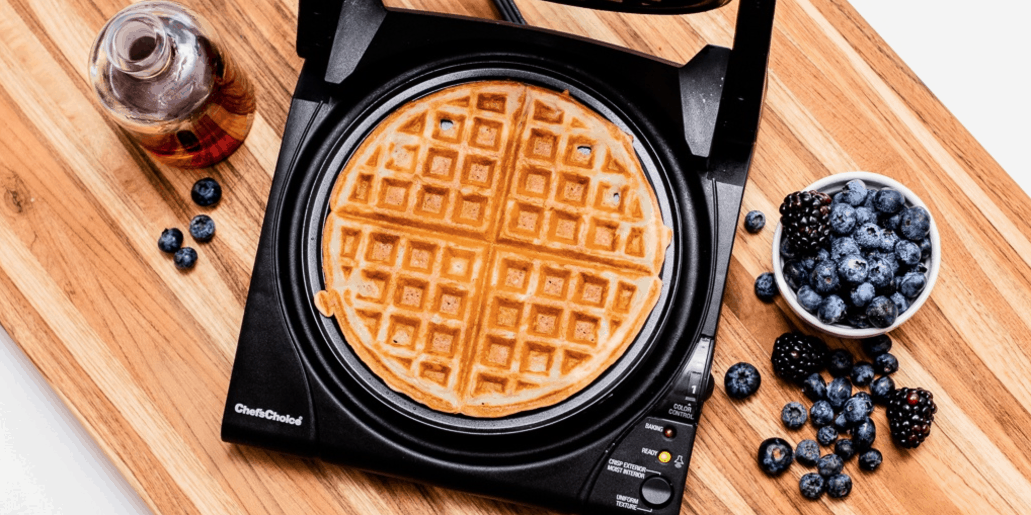 Waffle Maker with Blueberries and Syrup to the Side