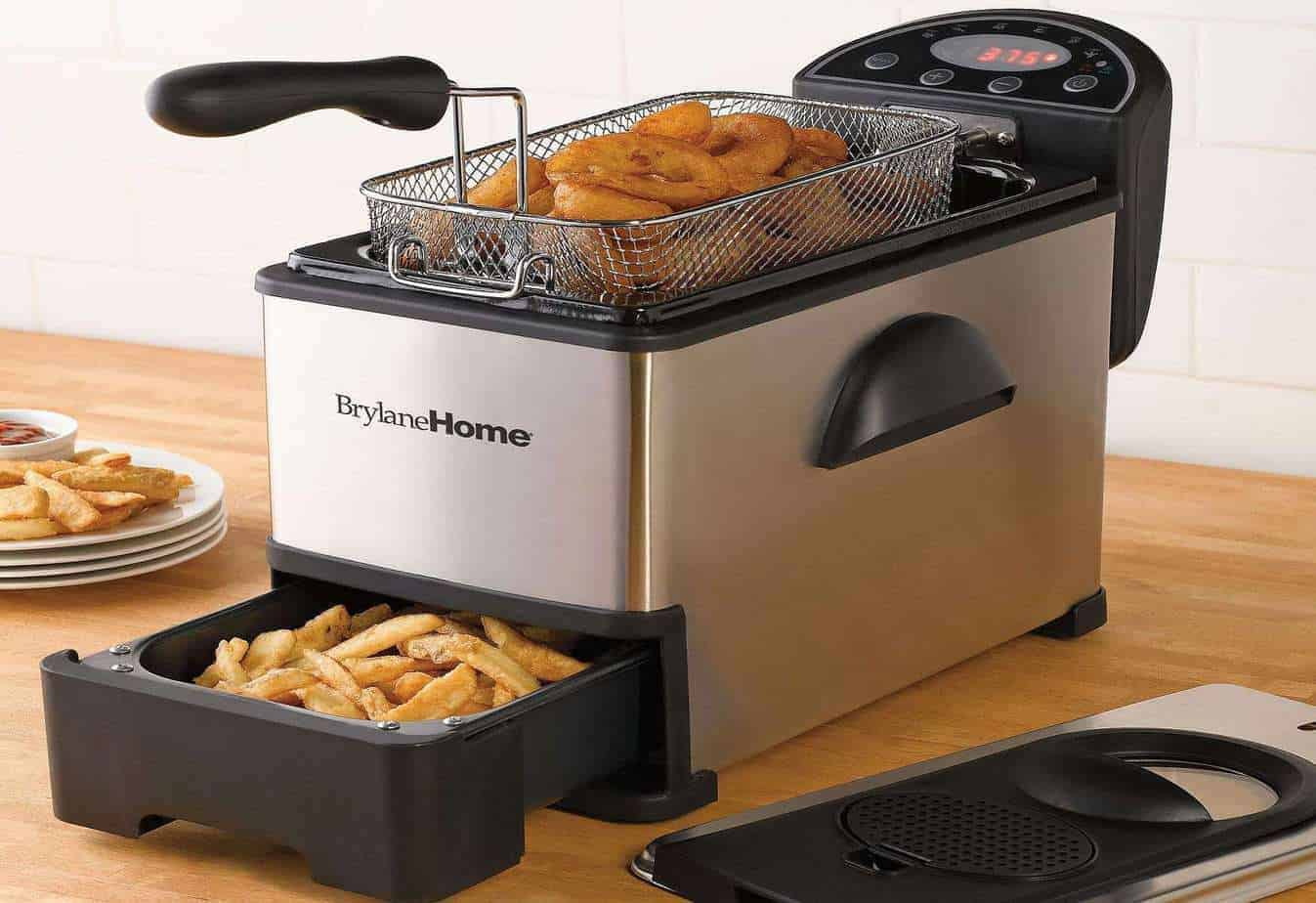 Deep Fryer with onion rings and french fries