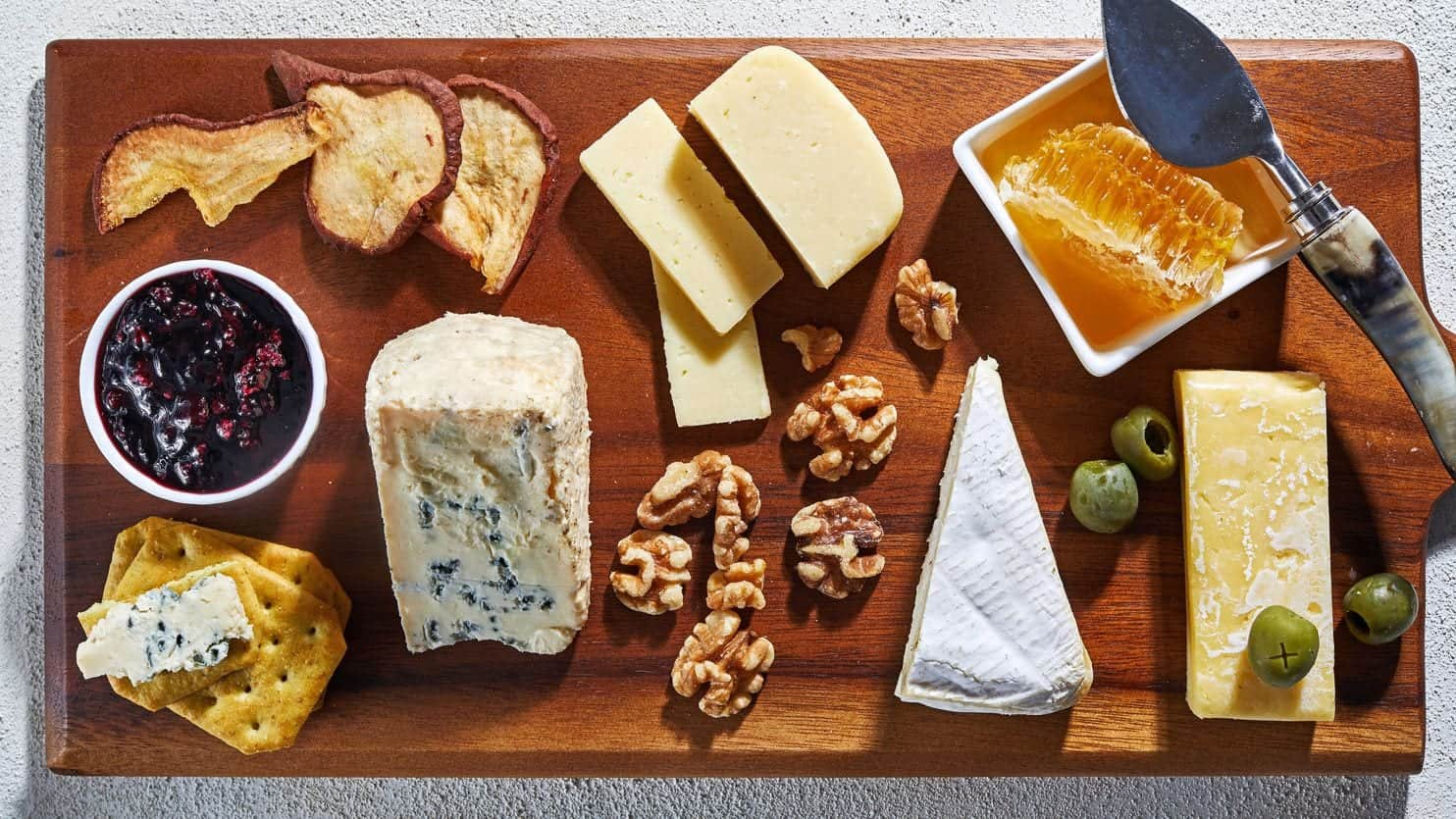 Cheese platter on cutting board