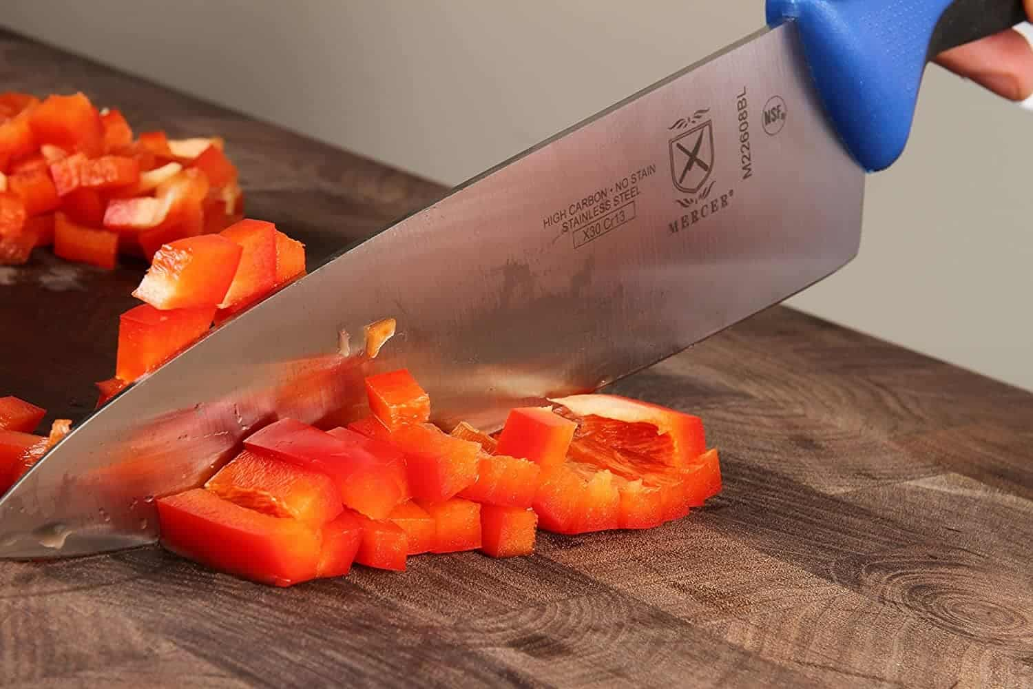 Chopping peppers with chef knife