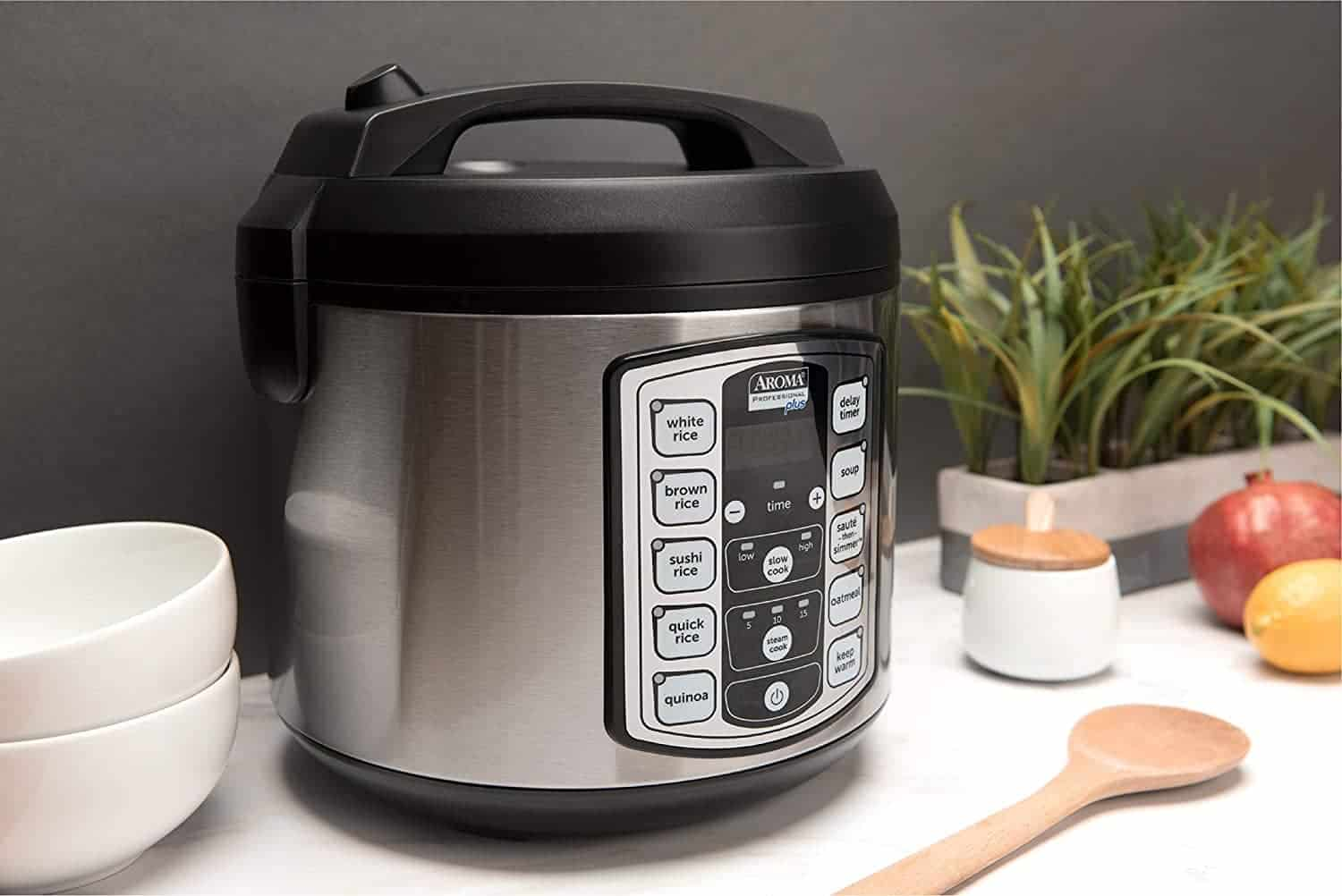 Rice cooker on a counter with utensils