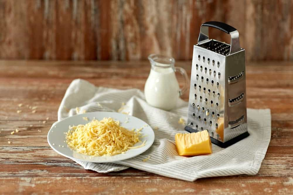 Grating cheese with a box cheese grater
