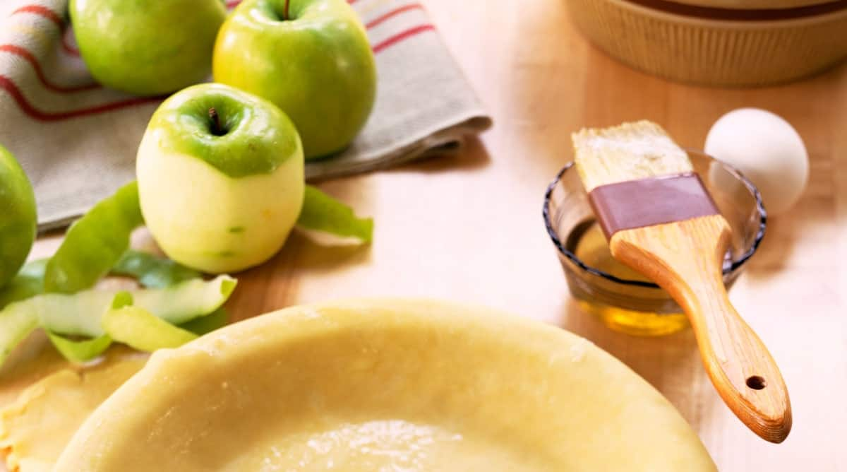 Pie crust dough , and apples