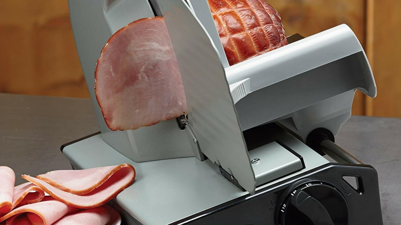 Slicing ham with a meat slicer