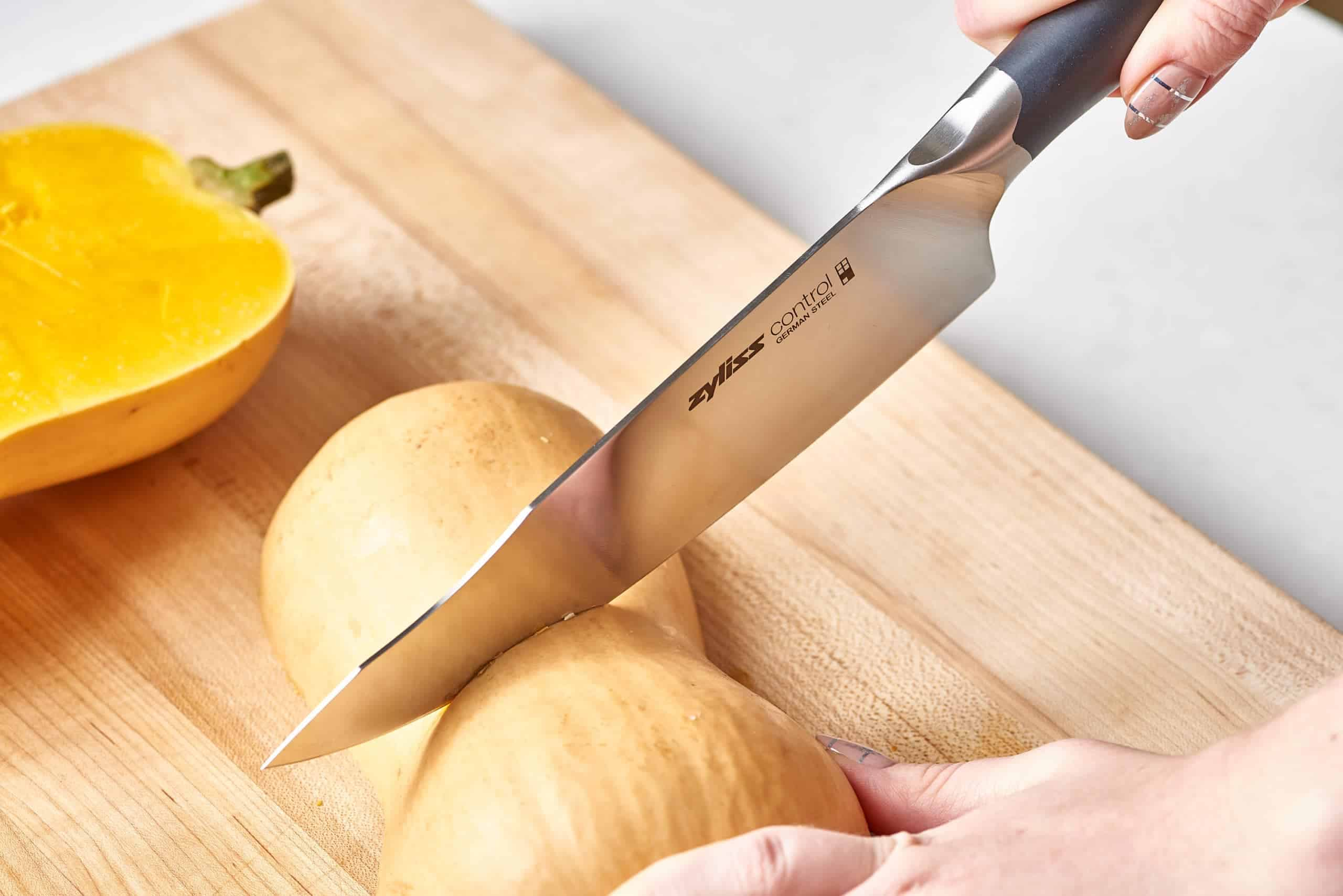 Chef Knife Cutting Through Squash