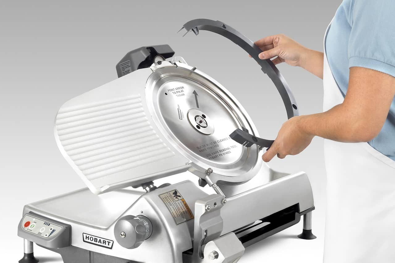Remove blade from meat slicer