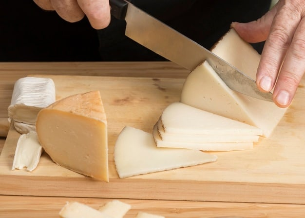 Shredding cheese with a knife