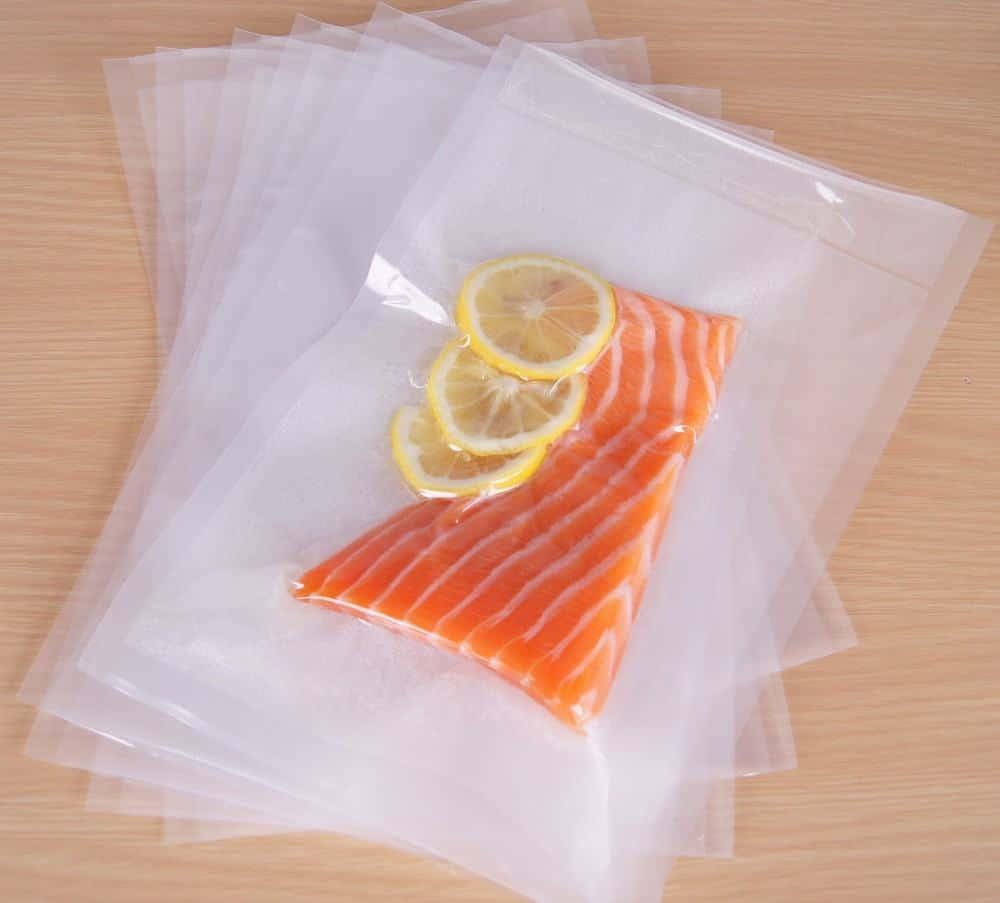 Vacuum sealer bags with salmon and lemon