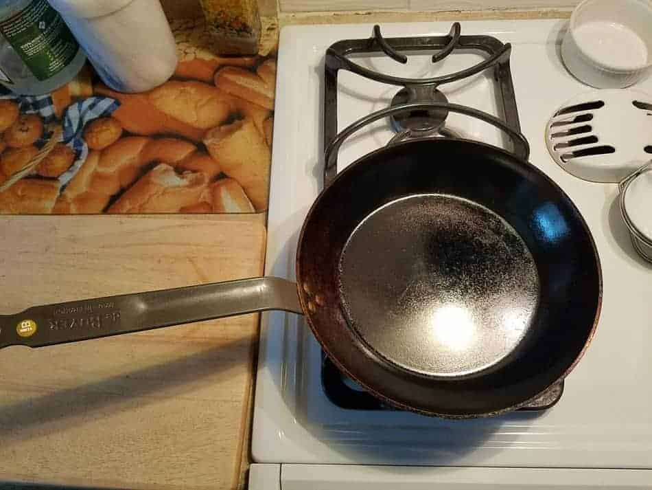 Dry carbon steel pan on stove