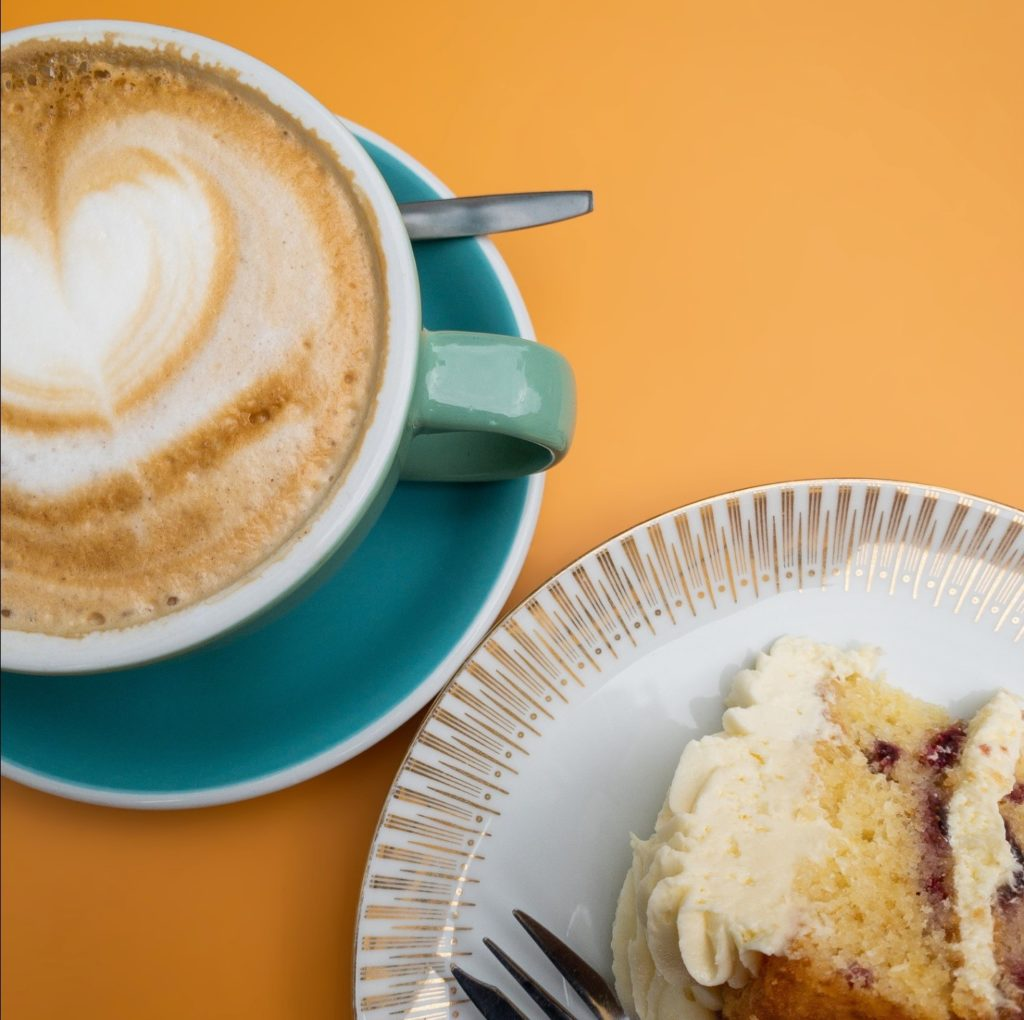 A Cup of Cappuccino on a Green Saucer