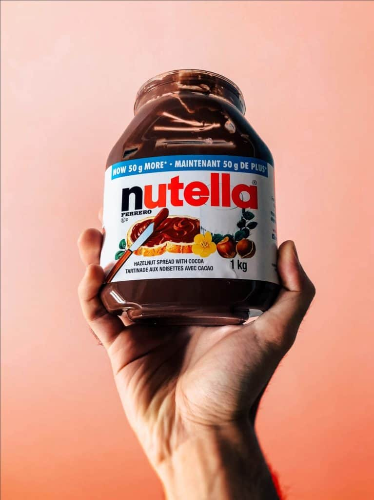 Person Holding a Nutella Jar