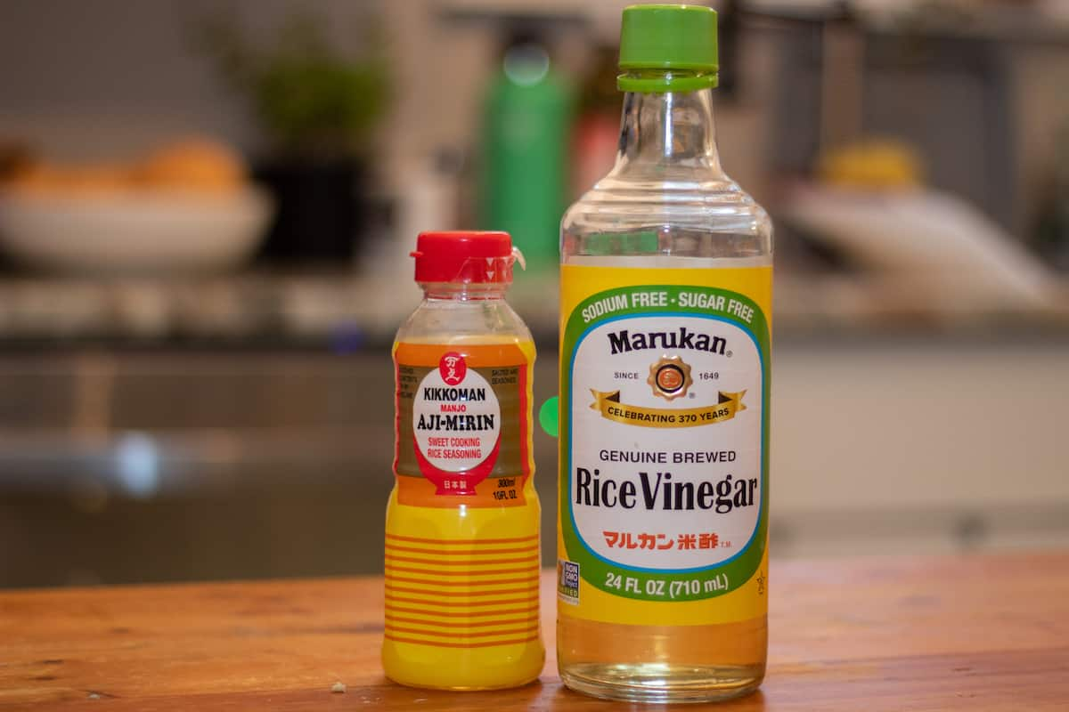 mirin and rice vinegar sitting on a countertop