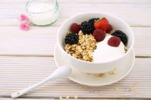yogurt parfait bowl with granola and berries
