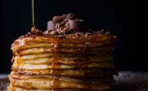 pancakes with syrup and chocolate on a platter